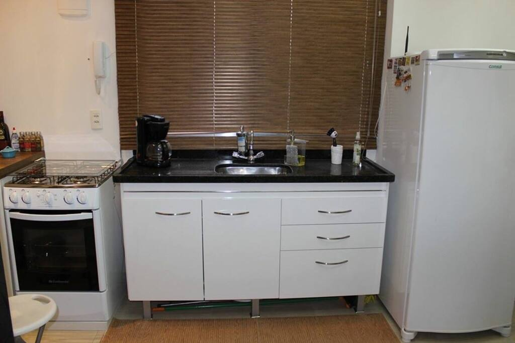Stove, sink, coffee maker, full size refrigerator