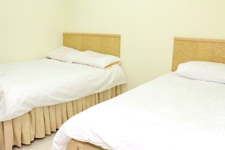This is a triple room with private bathroom for 3 people.  1 double bed + 1 single bed We are a hostel with 11 rooms Key area: can reach 3 MTR stations in 5 mins: Kowloon, Jordan & Austin