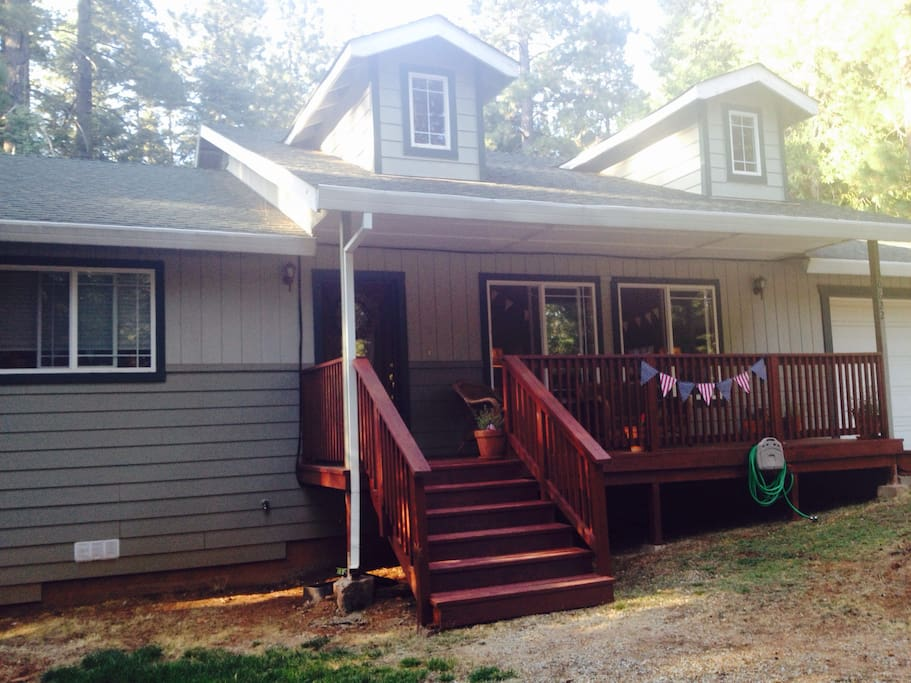Family home, nestled in Shingletown, surrounded by pines. Front porch privacy & large back deck.