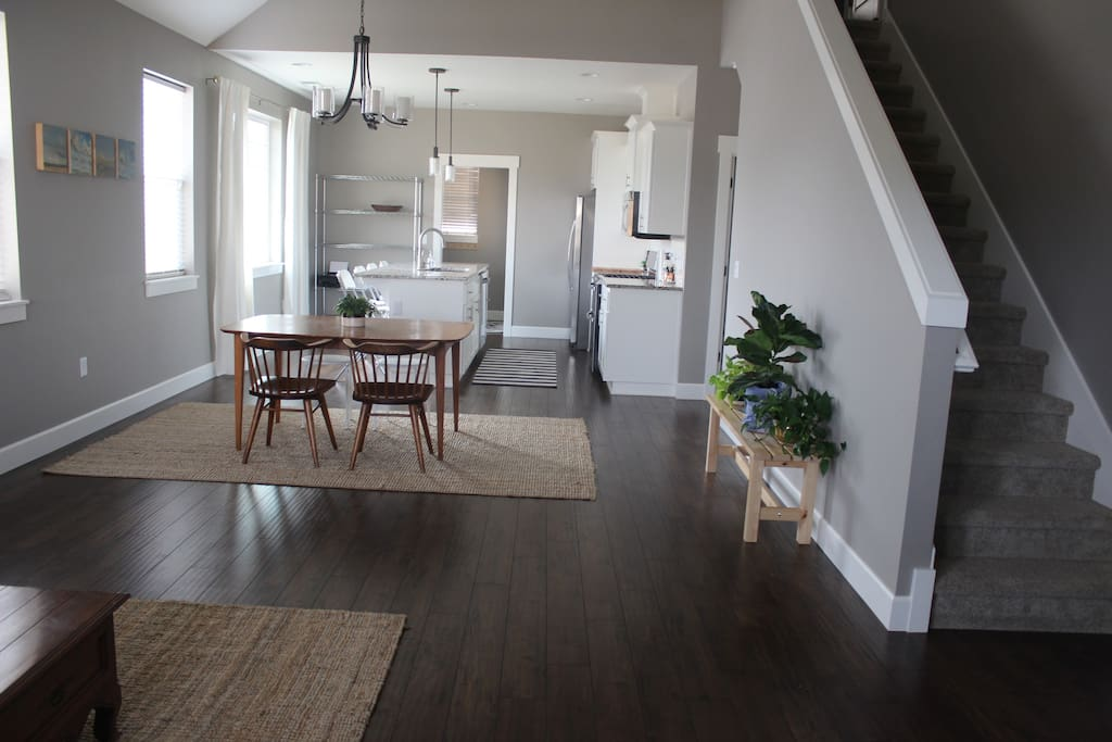 Open floor plan with beautiful natural light. Stairs go up to the loft.
