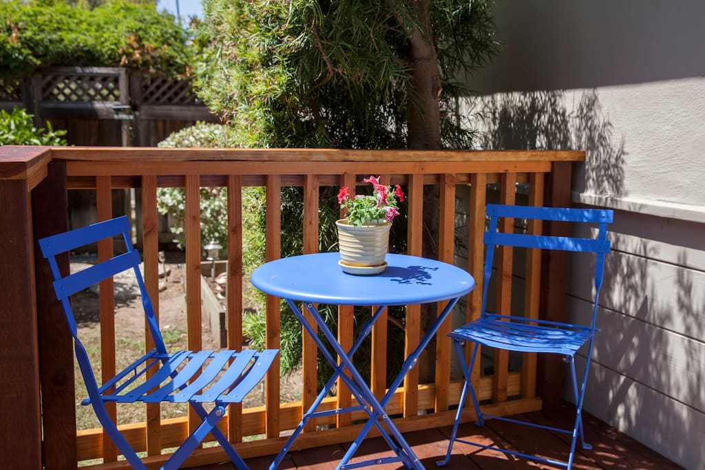 Your own private deck in the garden — perfect for your morning coffee or evening glass of wine!