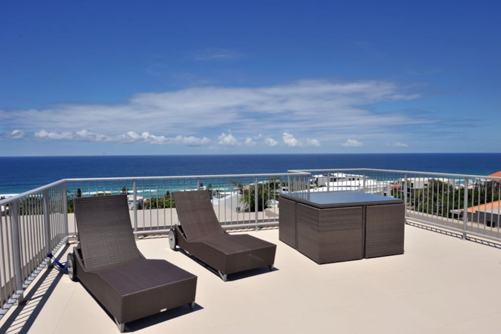 Relax in the sun on your private rooftop deck