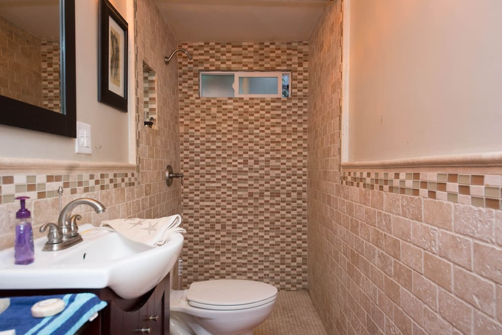 Shower has glass tiles.. and a shower curtain not shown!