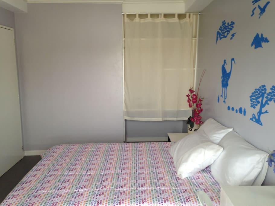 Queen bed third floor room 4
