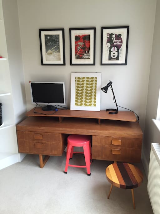 Dressing table and drawers for your things. A monitor if you want to connect your laptop and watch movies or use internet on a bigger screen