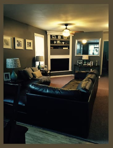 "Living room sitting area with 50"" HD 3D Television. Sectional Sofa can accommodate an entire family for movie night."