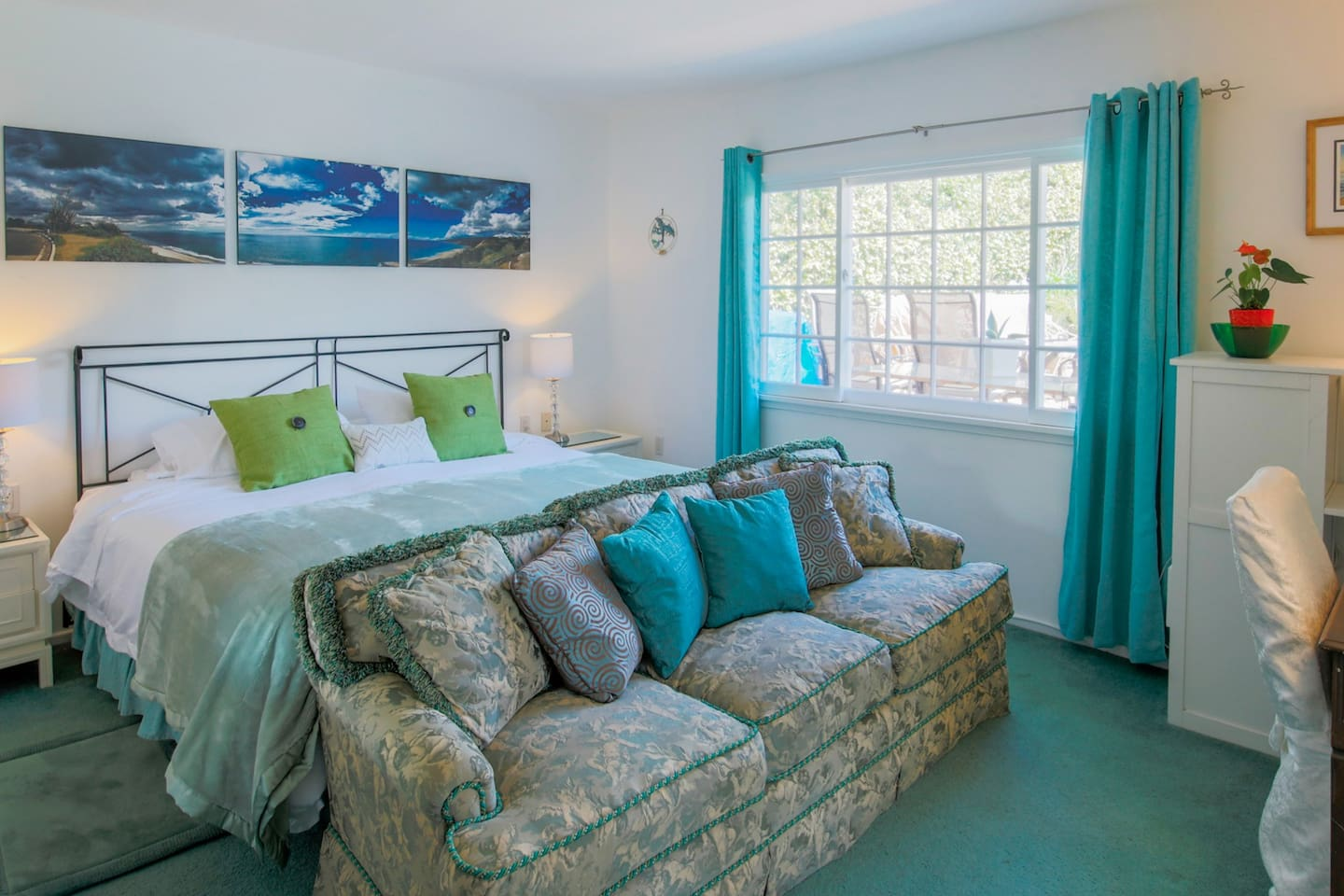 Spacious, well lit master bedroom with luxurious king sized bed.