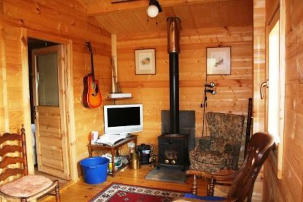 The Chalet lounge showing the Log Burner and how cosy it is.
