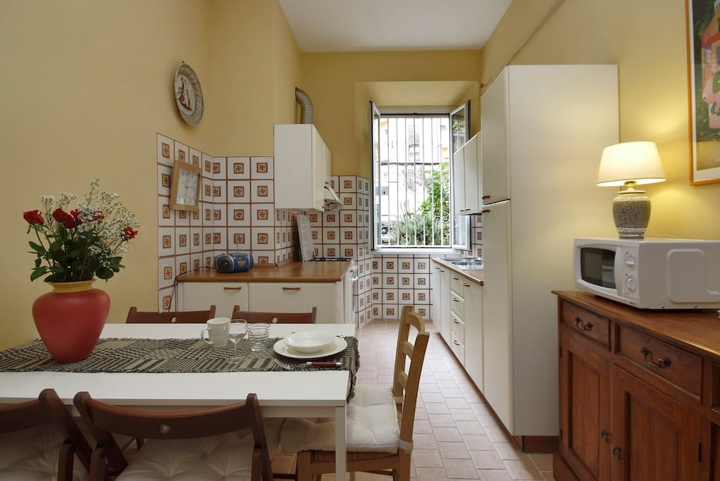 Fully furnished kitchen with everything one needs to cook and have home-meals