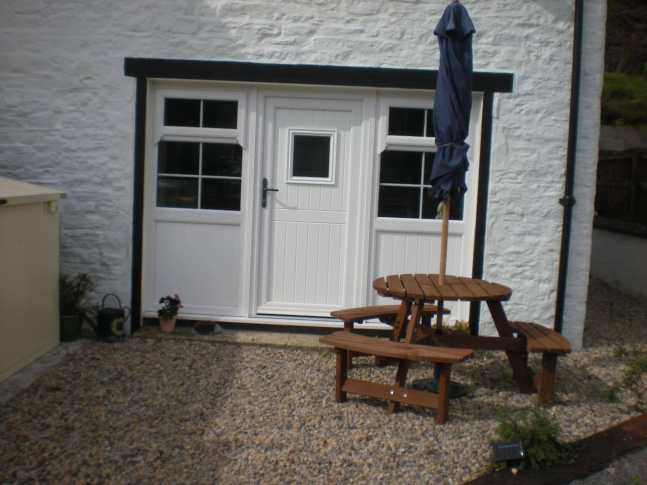 Bunkhouse with outside sitting area.