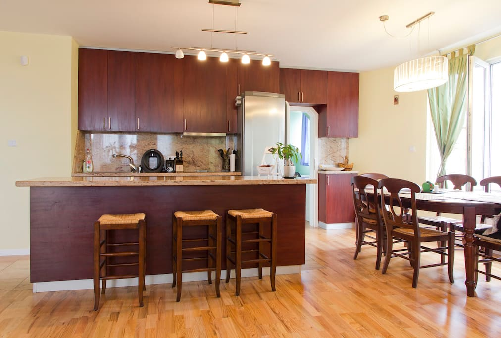 Upscale kitchen with island and separate dining area