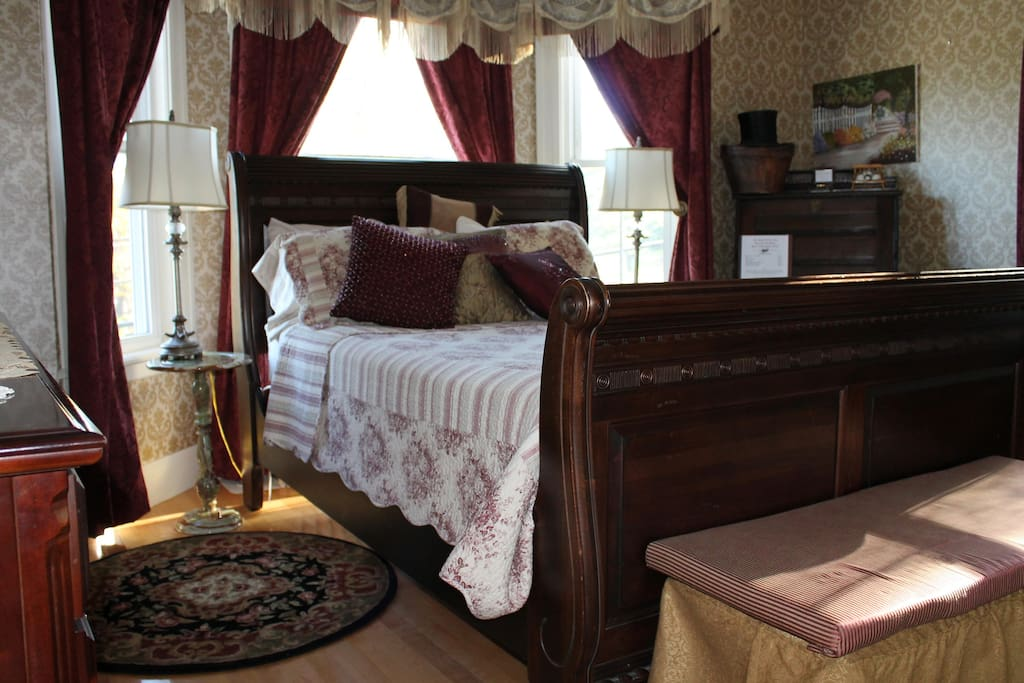 This room is rich in color and decor. Features a Queen Sleigh bed, custom drapes, antique furniture yet has all the amenities you require.