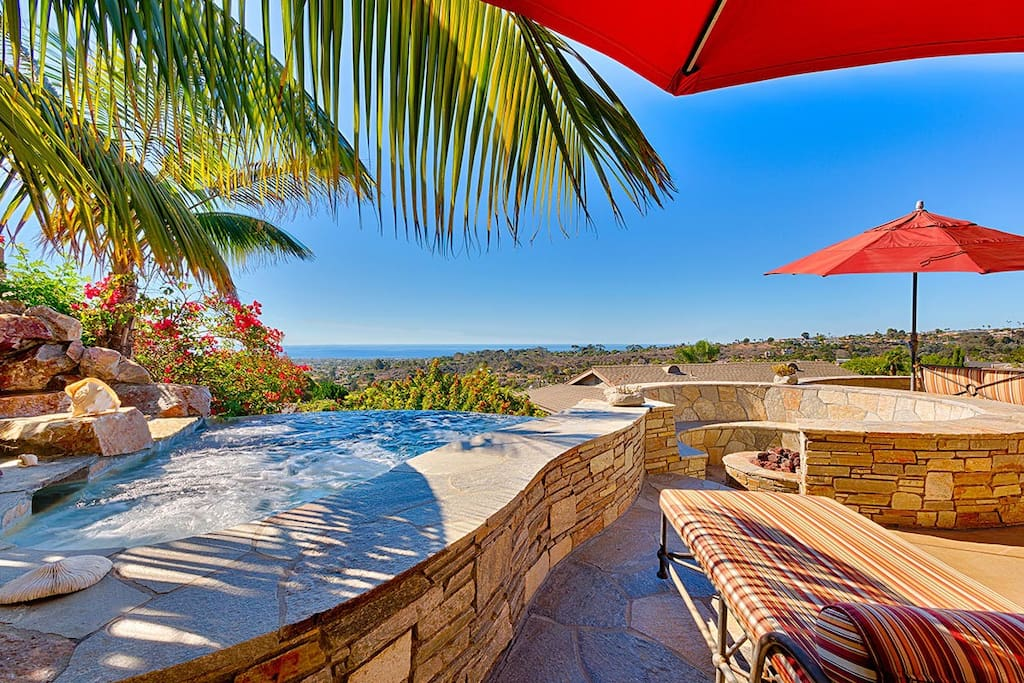Stone and Tile Back Patio with Ocean Views, Hot Tub, and Fire Pit