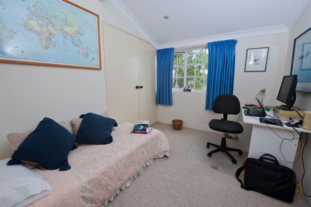 Single bedroom with single bed and computer plus desk