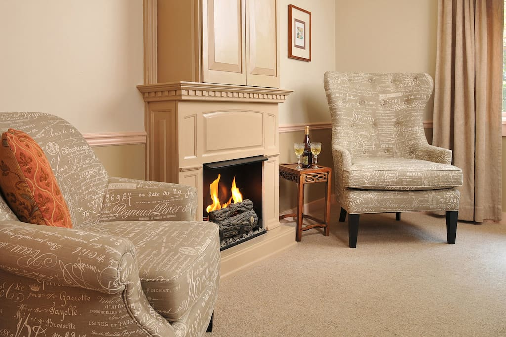 Cozy seating around a Real Flame fireplace