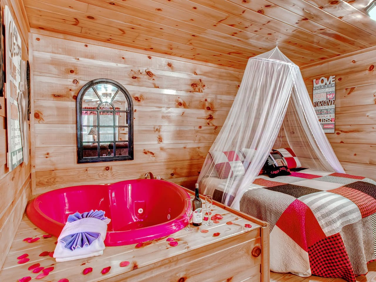 King size round bed with red heart shaped jacuzzi
