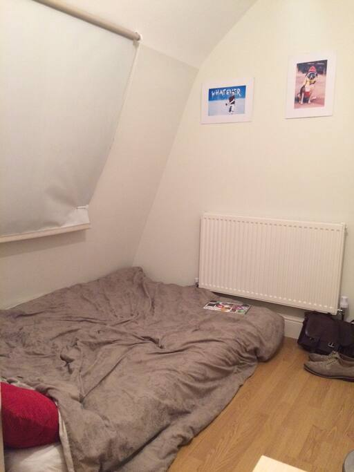 Double bed on the floor.