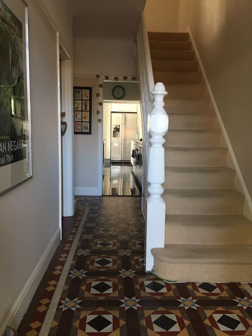 Light and spacious hallway with access to lounge and kitchen