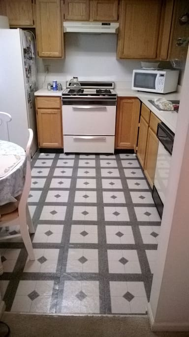 eat in kitchen seats four with pantry, washer, dryer, appliances, cooking supplies, plates, cups, flatware, kurig coffee maker.