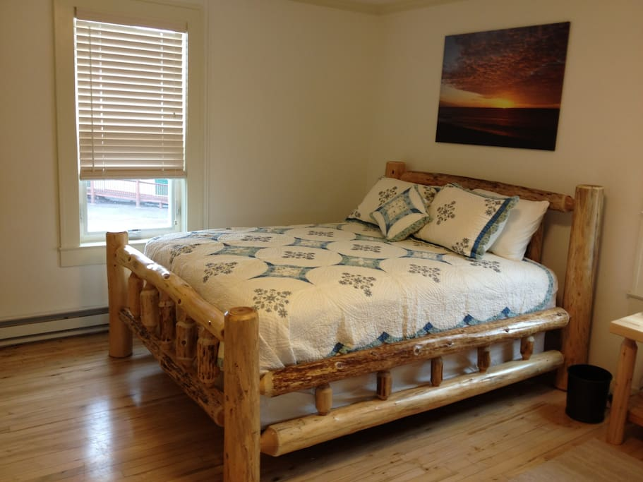 Second queen bed in  north bedroom; also a dresser, boot tray, coat tree, and towel cupboard (many extra towels!).