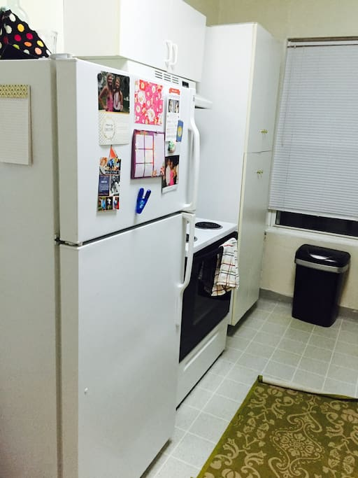 Kitchen with refrigerator, oven, microwave, toaster oven, keurig