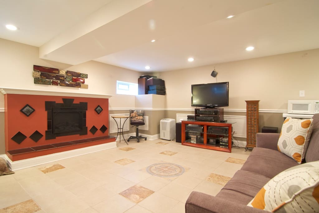 This is the main living space showing the electric fireplace and surround sound TV/Stereo.