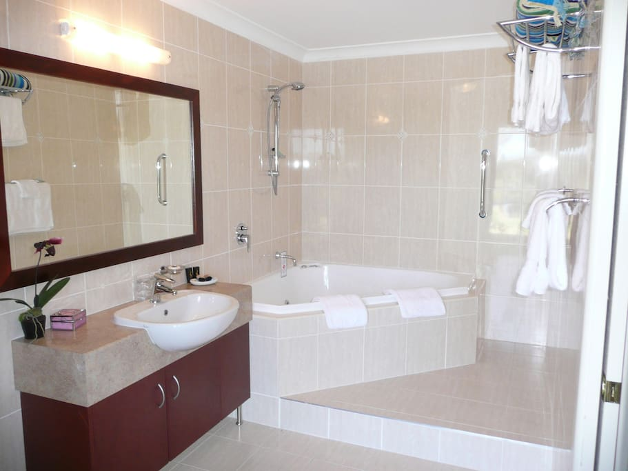 One of the guests' own ensuite spa bathrooms