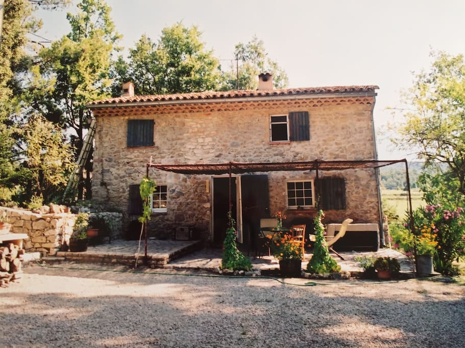 The stone cottage with its terrace