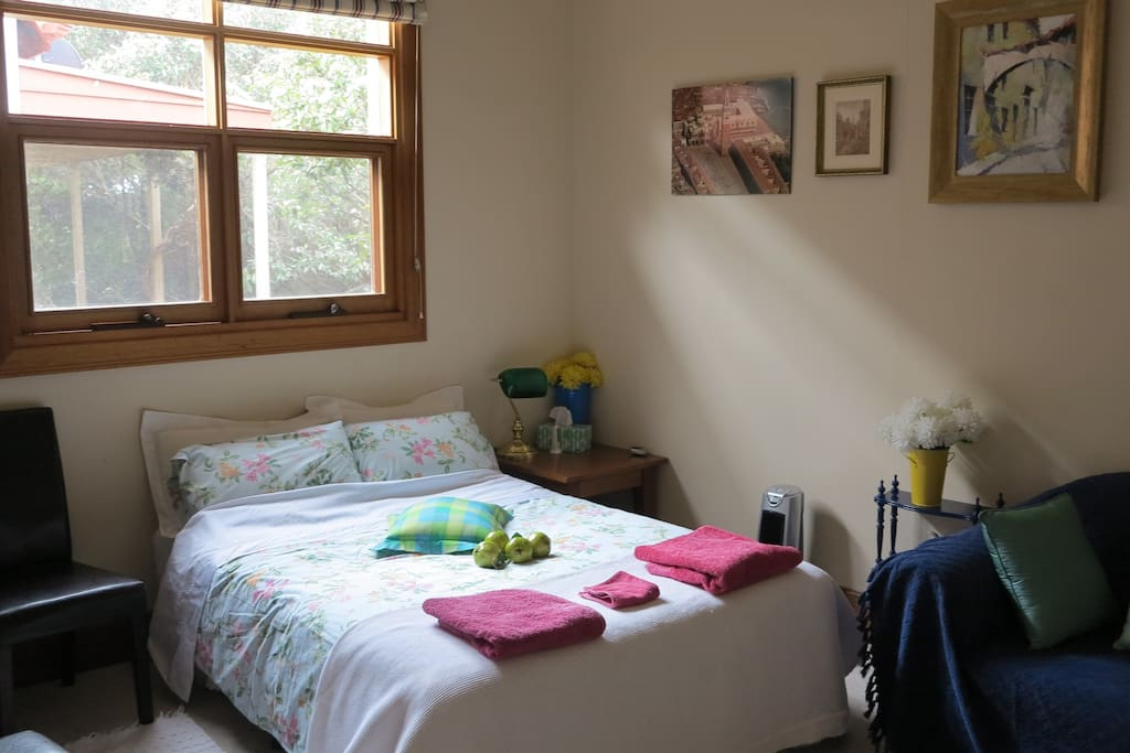 Bright and sunny bedroom with additional fold out sofa for children or extra members of family