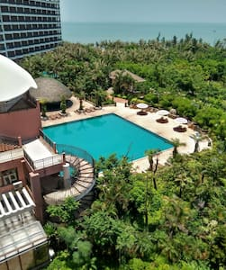 面朝大海漫步绿荫的海畔酒店公寓泳池温泉尽享舒适休闲的假期 - 海口 - Wohnung