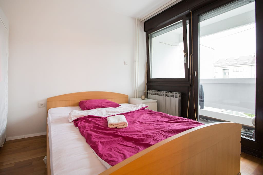 Bedroom with balcony, park view, quiet with no traffic noise.