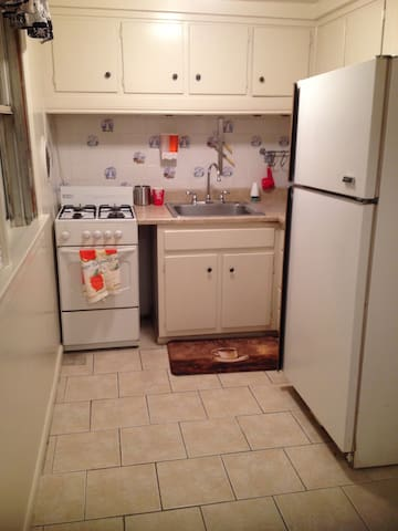 Shared kitchen with full size refrigerator