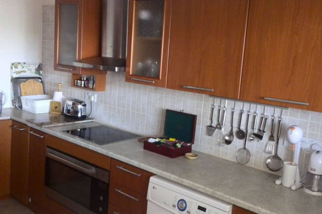 A modern fully equipped kitchen, iron provided.