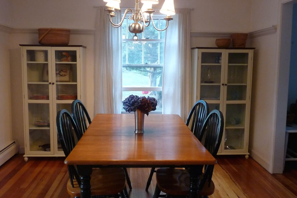 Dining room, adjacent to kitchen/powder room/laundry and living room.