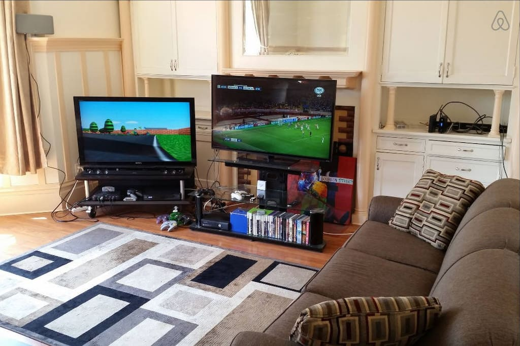 Living Room with 2 TVs, Cable with 200+ channels, video game consoles, and lots of couch seating