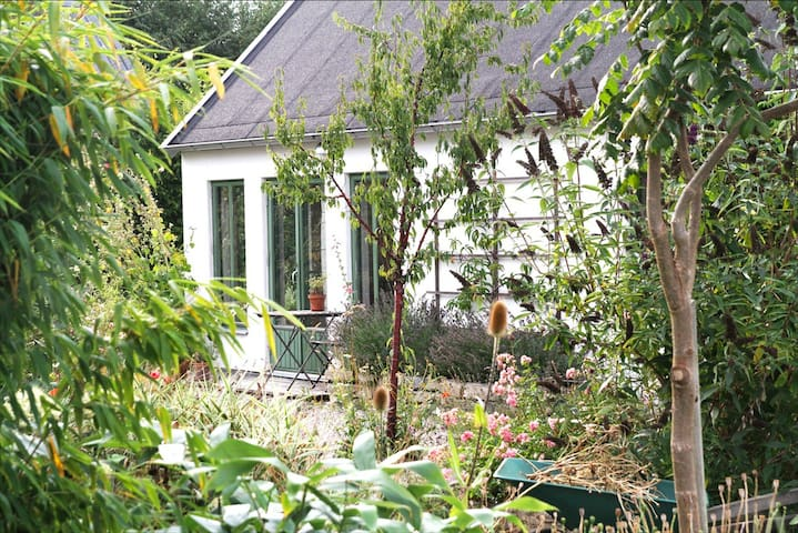 Guest house in lush garden