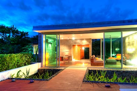 Experience Costa Rica in this zen-like modern home surrounded by 40-acres of tropical forest.  Watch toucans and many other exotic birds from the deck, or take a nature tour around the lake- all less than one kilometer from beautiful Bejuco beach!!