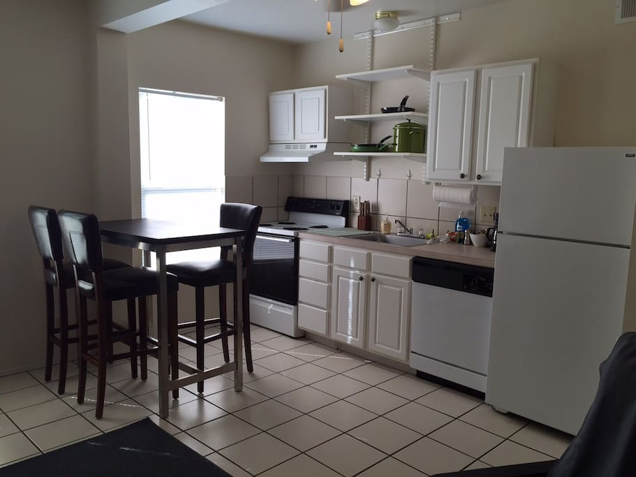 Kitchen /Dining Area - kitchen is fully stocked with pots and pans, dishes, glassware and silverware.  Full size stove and refrigerator, coffeemaker and microwave are also included.