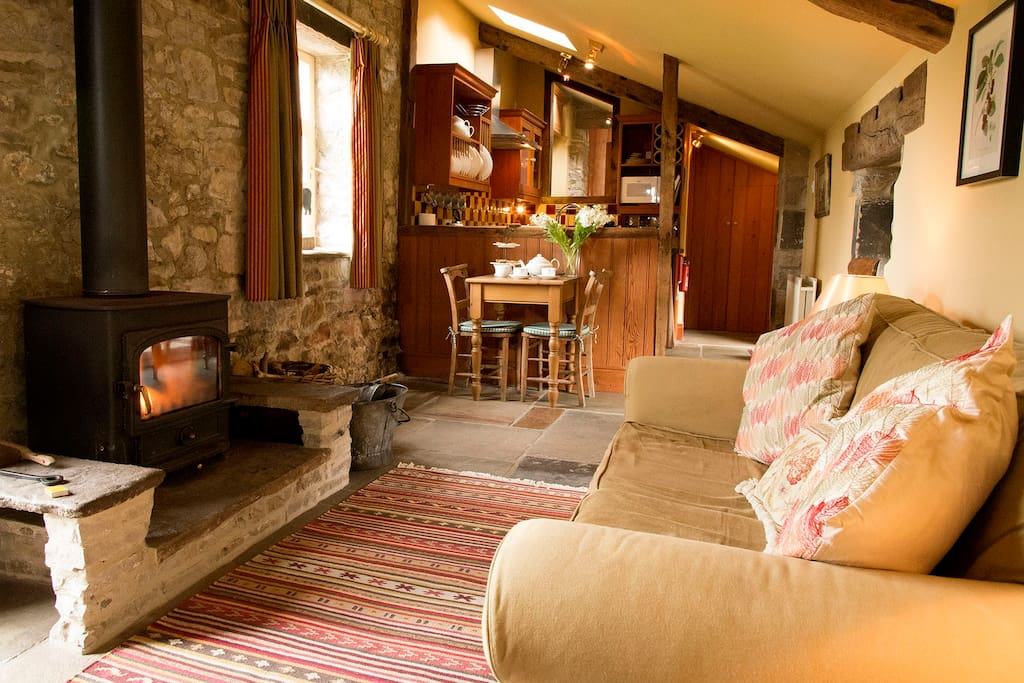 Cosy sitting room which leads into the kitchen.