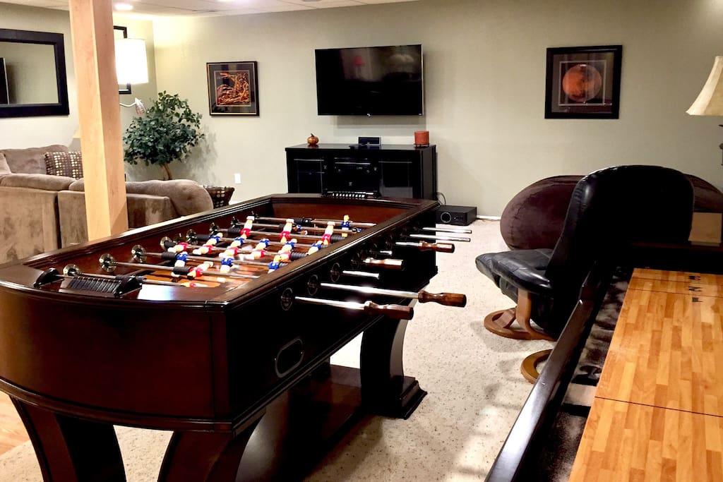 Downstairs theater/game room has big flat TV, foosball, wet bar, shuffle board and comfortable seating.