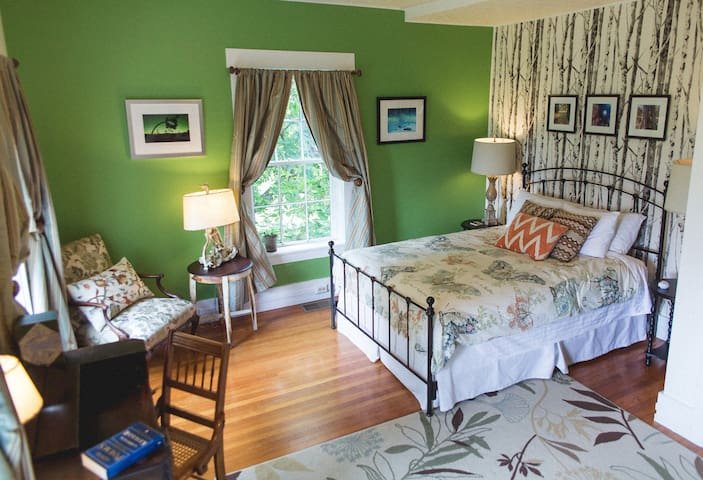The John Daley room - queen bed, writing desk, comfy chair and private bath steps across the hall.