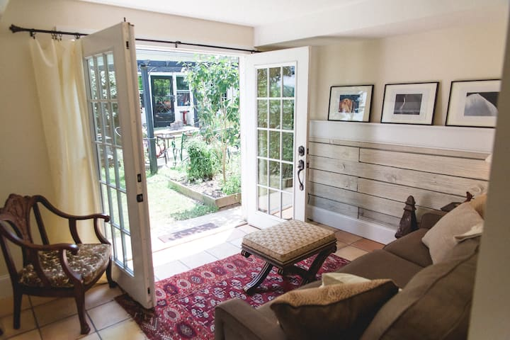 The Carriage House - sitting room with direct access from the courtyard, queen sleeper sofa.