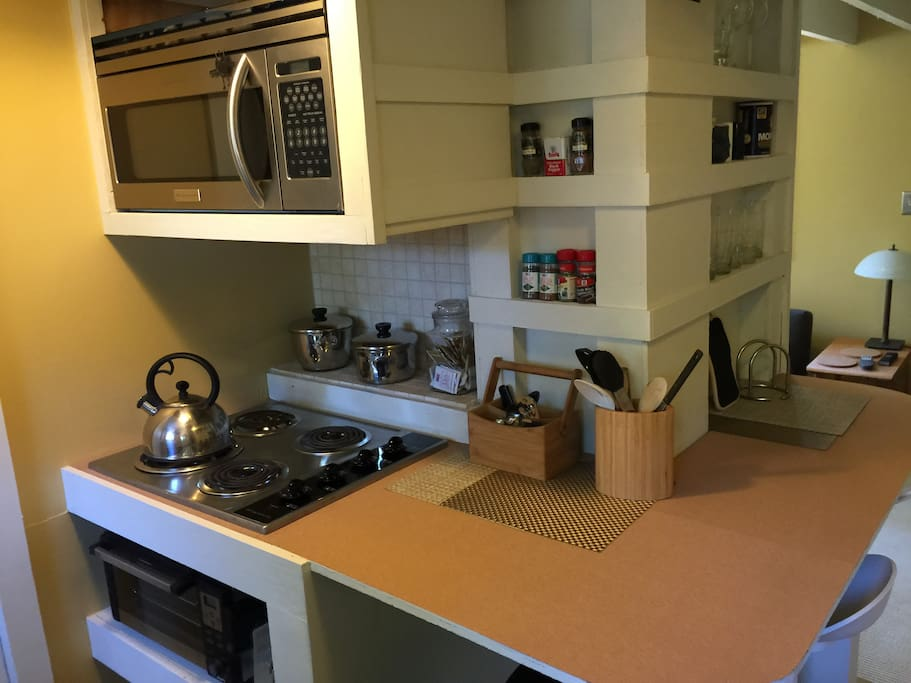 Summer kitchen includes a stovetop,  microwave, dishwasher and other amenities.  oven.