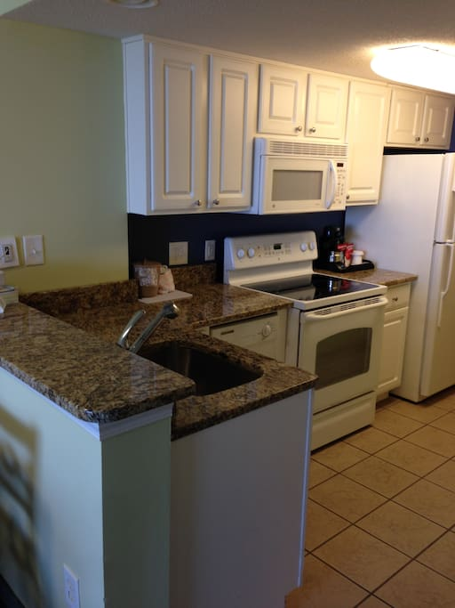 New updated fully equipped kitchen, granite countertop