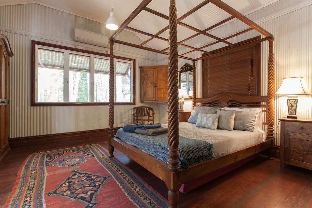 Warm and inviting, the main bedroom at Pearler's Cottage
