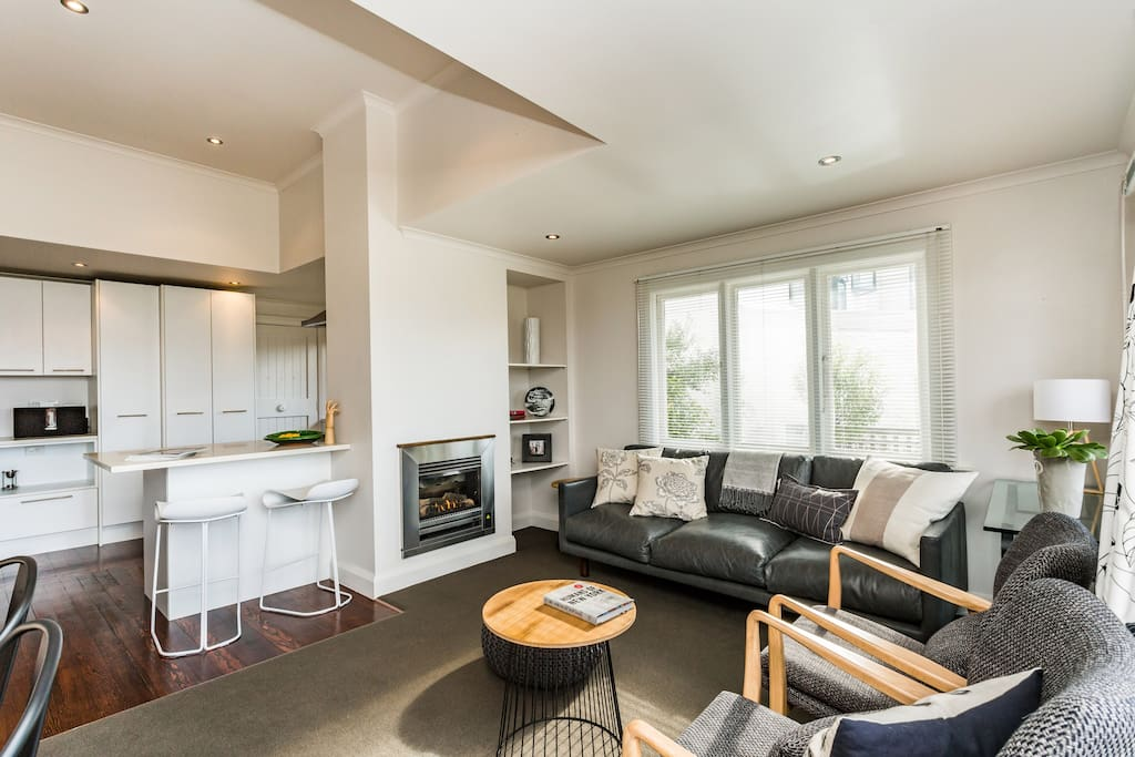 Stylish living area heated by gas fire