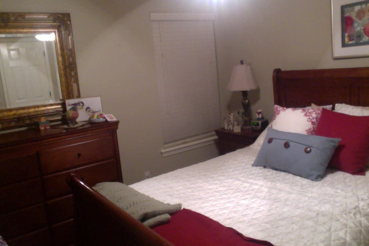 Bedroom off a large den with ceiling fan and queen size sleigh bed