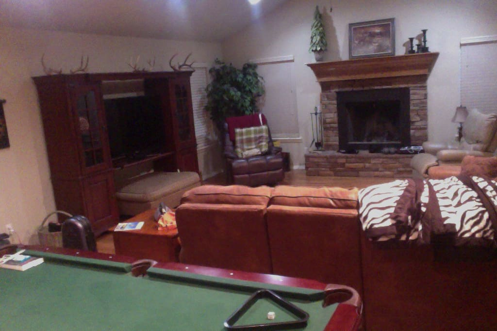 Large den with pool table and access to covered patio