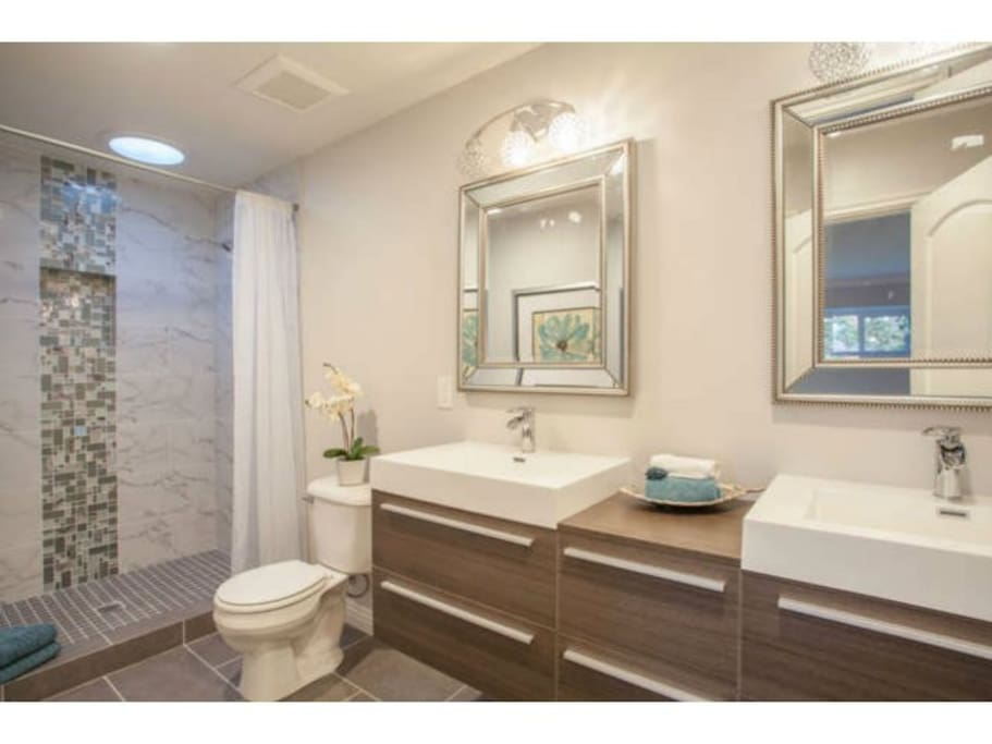 Private, ensuite bathroom with dual sinks and shower