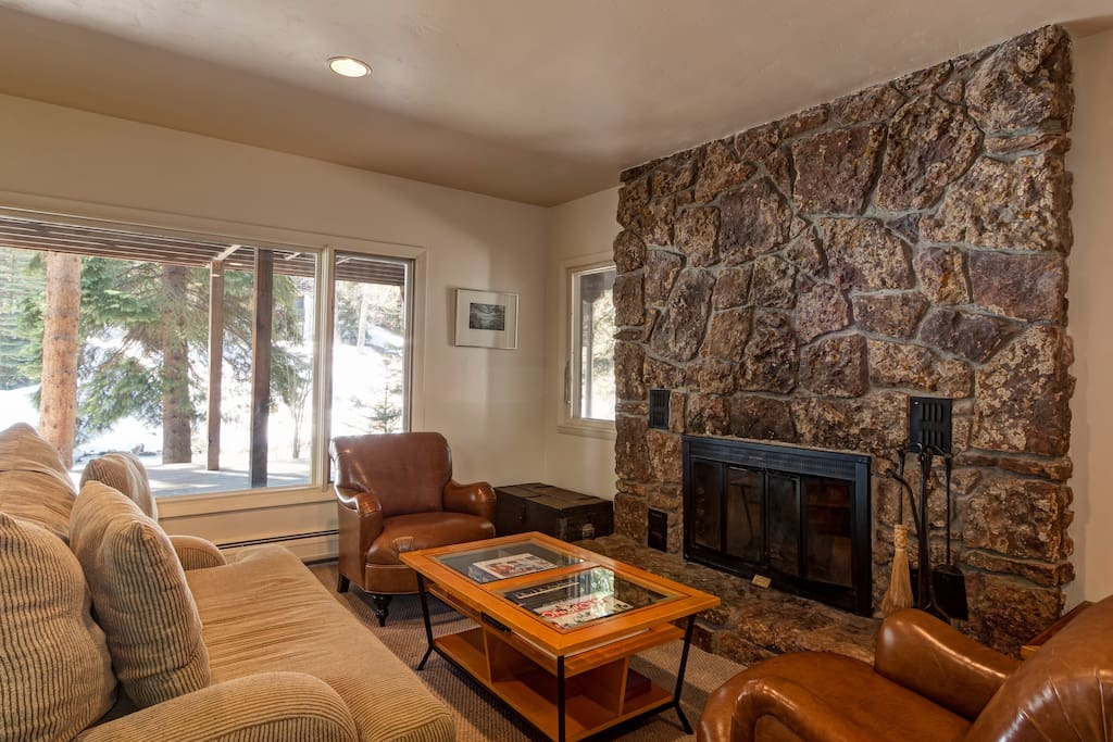 Living area with Wood Burning Fireplace and creek views